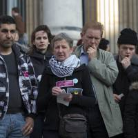 Mourners gather at Beursplein Square in Brussels on Tuesday to pay tribute to victims of the bomb attacks.  | BLOOMBERG