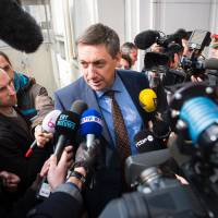 Belgian Vice Prime Minister and Interior Minister Jan Jambon talks to journalists as he arrives for a meeting of the national security council in BrusselsWednesday following a shootout the day before during a major Belgian-French anti-terror operation in the city's Forest district. | LAURIE DIEFFEMBACQ / BELGA / AFP-JIJI
