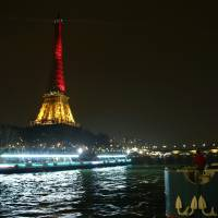 The Eiffel Tower in Paris is illuminated in the colors of the Belgian flag Thursday in tribute to the victims of terrorist attacks in Brussels. | AFP-JIJI