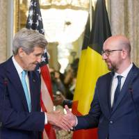 U.S. Secretary of State John Kerry shakes hands with Belgian Prime Minister Charles Michel after delivering a joint statement at the Belgian Prime Minister's Residence in Brussels on Friday. | REUTERS