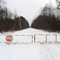 This photo taken on Feb. 21 shows the gate at the entrance of the sanitary protection zone around the Krasny Bor hazardous waste landfill near St. Petersburg, Russia. | AFP-JIJI