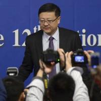 Chinese Environment Minister Chen Jining arrives at a news conference in Beijing on March 7, 2015. | REUTERS