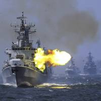China's Harbin guided missile destroyer takes part in a weeklong China-Russia 'Joint Sea-2014' navy exercise in the East China Sea off Shanghai in May 2014. | CHINA PHOTO / AP