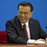 Chinese premier says China-Japan relations improving but 'still fragile'