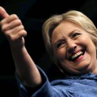 U.S. Democratic presidential candidate Hillary Clinton gives a thumbs-up as she takes the stage at her campaign rally in West Palm Beach, Florida, Tuesday. It was reported Thursday that she won the Missouri primary. | REUTERS