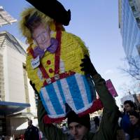 A protester holds up a Donald Trump piñata outside of the Verizon Center where the 2016 American Israel Public Affairs Committee (AIPAC) Policy Conference is taking place in Washington Monday. Republican presidential candidates Donald Trump, John Kasich and Ted Cruz are speaking at the conference Monday. | AP