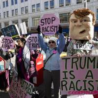 Demonstrators protest outside of the Verizon Center in Washington Monday. Republican presidential candidate Donald Trump is scheduled to speak at 2016 AIPAC Policy Conference. | AP