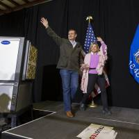 Republican presidential candidate Sen. Ted Cruz and wife, Heidi, walk on stage before the candidate spoke at a campaign stop Thursday in Dane, Wisconsin. | AP