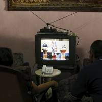 Cubans glued to sets to view rare press grilling of Castro, Obama