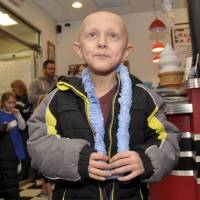 Dorian Murray looks up to applause and cheers at a community birthday party for him at Mel's Downtown Creamery in Pawcatuck, Connecticut, on Jan. 10. | AP