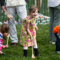 Children participate in the White House Easter Egg Roll on the South Lawn of the White House in Washington Monday. | AP