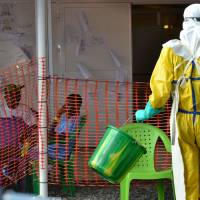 Just as WHO declares global threat eased, Ebola kills seven in Guinea; over 1,000 being monitored