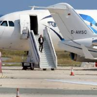 A man believed to be the hijacker of the EgyptAir Airbus A-320, which was diverted to Cyprus, leaves the plane before surrendering to security forces after a six-hour standoff on the tarmac at Larnaca airport's largely disused old terminal on Tuesday. | AFP-JIJI