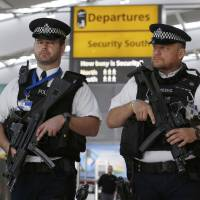 Police patrol Heathrow Airport's Terminal 5 in London on Tuesday. | REUTERS