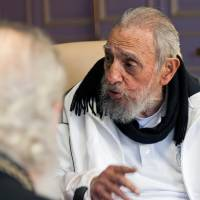 Cuban leader Fidel Castro meets Russian Orthodox Patriarch Kirill (left) in Havana in February. In a text published on Munday, Castro said, 'We do not need for the empire to give us anything,' in reference to the recent visit by U.S. President Barack Obama to Cuba. | AP
