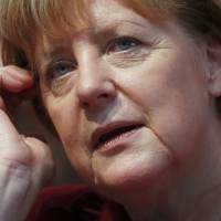German Chancellor Angela Merkel, leader of the conservative Christian Democratic Union (CDU) party, attends a Baden-Wuerttemberg state election campaign rally in Haigerloch, southwestern Germany, on Saturday ahead of Sunday's regional elections. | REUTERS