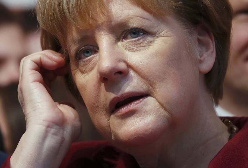 German anti-immigration party wins big in election setback for Merkel party