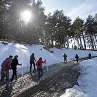 Relatives awalk at the crash zone in Le Vernet, France, Thursday during the first anniversary ceremony to commemorate the 150 victims of the Germanwings Airbus A320 that crashed in a remote area of the French Alps near Seyne-les-Alpes. | REUTERS