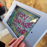 Alice Filipponi, from the Opera di Santa Maria del Fiore, writes digital graffiti reading 'Do not write on walls' on a tablet screen on March 17 in Florence, Italy. | AFP-JIJI
