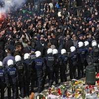 Right-wing demonstrators protest a wave of terrorism in front of the old stock exchange in Brussels on Sunday. | REUTERS