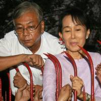 Htin Kyaw stands with Aung San Suu Kyi at her residence in Yangon on Nov. 13, 2010, the day of her release from nearly two decades of house arrest. | AFP-JIJI
