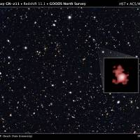 This image provided by the Space Telescope Science Institute, taken with the Hubble Space Telescope, shows a hot, star-popping galaxy that is far, far away, farther than any previously detected, from a time when the universe was a mere toddler of about 400 million years old.   SPACE TELESCOPE SCIENCE INSTITUTE VIA AP