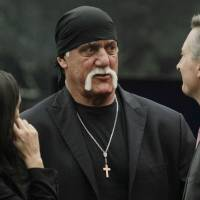 Hulk Hogan, whose real name is Terry Bollea, speaks with people before his trial against Gawker Media, in St. Petersburg, Florida, on Thursday. | REUTERS