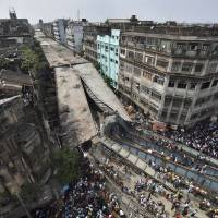 At least 15 killed, many trapped in overpass collapse in India