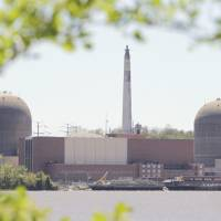 This file photo shows the nuclear power plant at Indian Point in Buchanan, New York, with the Hudson River in the foreground. | AP
