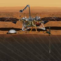 This illustration shows the InSight Mars lander studying the interior of Mars. | AP