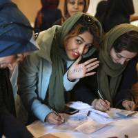 Iranian voters deal hardliners serious blow by booting them from legislature, clerical body