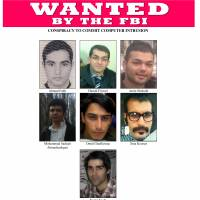 This image provided by the Justice Department shows the wanted poster for seven hackers tied to the Iranian government who were charged Thursday in a series of cyberattacks on dozens of banks and a small dam outside New York City. | AP