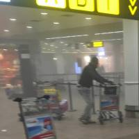 In this photo taken by Ketevan Kardava and provided by Georgian Public Broadcaster, a man injured in one of Tuesday's terrorist explosions lies on the floor at Brussels Airport.   AP