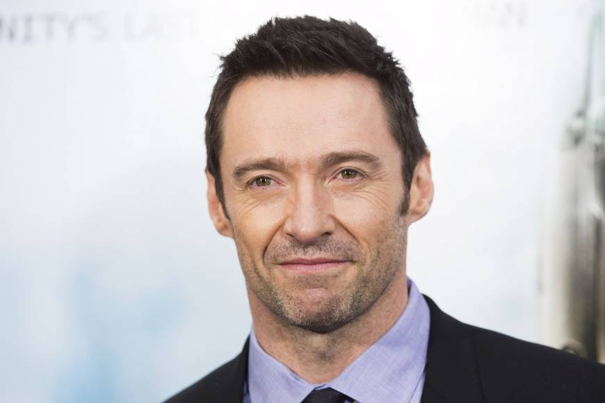 Australian actor Hugh Jackman helps swimmers to safety from dangerous surf