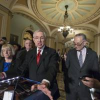 Senate Minority Leader Harry Reid, joined by (from left) Sen. Patty Murray, Senate Minority Whip Richard Durbin and Sen. Charles Schumer, talks to reporters on Capitol Hill in Washington March 8 following a closed-door policy meeting. | AP