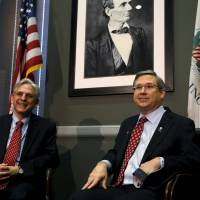 U.S. Sen. Mark Kirk (right) meets with President Barack Obama's Supreme Court nominee, Merrick Garland, on Capitol Hill in Washington Tuesday. | REUTERS