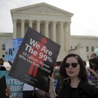 Supporters of contraception rally before Zubik v. Burwell, an appeal brought by Christian groups demanding full exemption from the requirement to provide insurance covering contraception under the Affordable Care Act, is heard by the U.S. Supreme Court in Washington Wednesday. | REUTERS