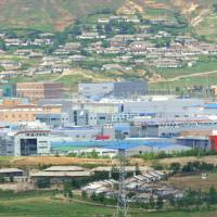 The inter-Korean industrial complex of Kaesong is seen from a South Korean observation tower in Paju near the demilitarized zone separating the two Koreas in this May 2010 file photo. | AFP-JIJI