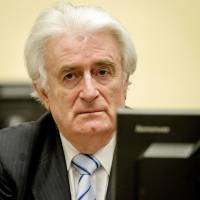 Srebrenica survivors say verdict on Karadzic too lenient, too late