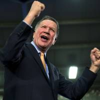 Republican presidential candidate and Ohio Gov. John Kasich celebrates during a presidential primary election rally in Berea, Ohio, on Tuesday. Kasich won the Republican primary there. | AP