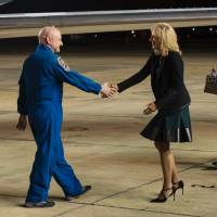 Dr. Jill Biden, wife of Vice President Joe Biden, greets Expedition 46 Commander Scott Kelly of NASA, after he landed at Ellington Field, Thursday in Houston. | JOEL KOWSKY / NASA / AFP-JIJI