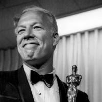 George Kennedy poses in 1968 with his Oscar in Santa Monica, California, after winning best supporting actor for 'Cool Hand Luke.' Kennedy died, Sunday of natural causes in Boise, Idaho, where he moved with his late wife in 2002. He was 91. | AP