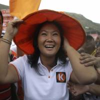 Peruvian presidential candidate Keiko Fujimori campaigns in a poor neighborhood of Lima on Monday. | AP