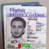 A photo posted online by PUK shows the Virginia driver's license found on a man who turned himself in to Kurdish forces in northern Iraq on Monday. | AP