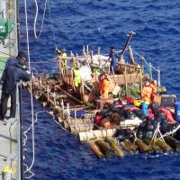 A handout picture released by the Chilean Navy on Friday shows one of two rafts that made a distress call off the coast of Chile. A freighter on Thursday rescued 14 crew members trying to make the same voyage as the famed Kon-Tiki expedition of 1947. | AFP-JIJI