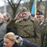 Latvia WWII vets who fought for Waffen SS stage contentious parade