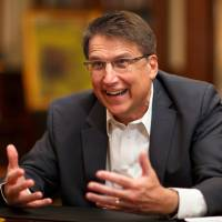 Pat McCrory, governor of North Carolina, speaks during an interview in the library at the executive mansion in Raleigh, North Carolina, on Wednesday, March 23. McCrory, a Republican, served as mayor of Charlotte from 1995-2009 before becoming governor in 2013.   BLOOMBERG