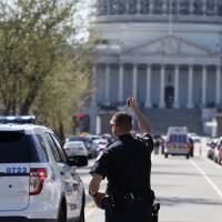 U.S. Capitol, White House lockdown ordered after man pulls gun, is shot