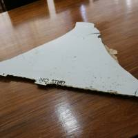 A piece of debris that may be part of be part of Malaysian Airlines Flight MH370 is pictured March 3 after being found off the coast of Mozambique by a South African vacationer. | AFP-JIJI