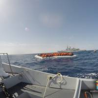 This handout picture released by the Italian Navy (Marina Militare) shows a rescue operation of migrants and refugees at sea off the coast of Sicily on Wednesday. More than 800 migrants were rescued by Navy ships during patrols in the Strait of Sicily as part of the Operation 'Mare Sicuro.' | MARINA MILITARE / AFP-JIJI